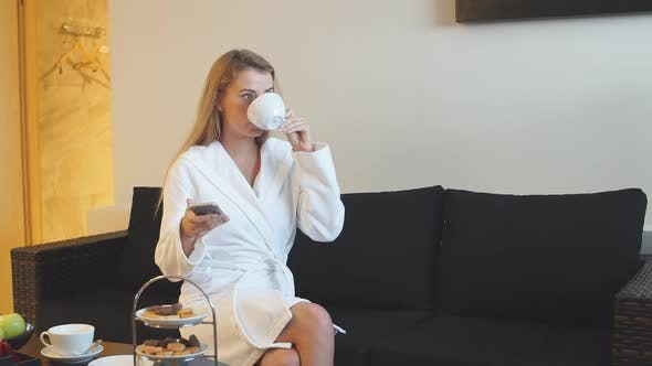 Thumbnail for Beautiful Young Girl Drinking Tea in Relaxation Room After Spa Treatments