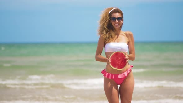 Thumbnail for Dancing Girl with a Half Juicy Watermelon on the Background of a Beautiful Sea.