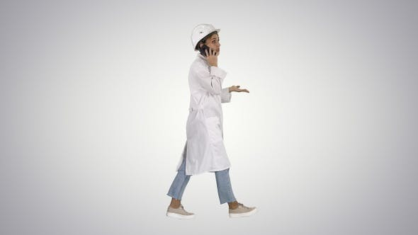Thumbnail for Female Scientist Making a Call Walking on Gradient Background.