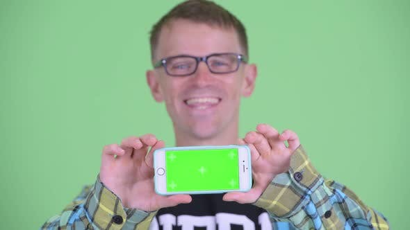 Thumbnail for Face of Happy Nerd Man Showing Phone