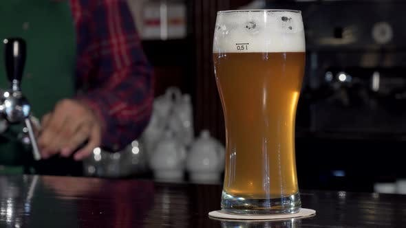 Thumbnail for Bartender Taking Away Glass of Beer From Bar Counter