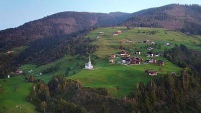 Aerial View of Villas and Church on Austrian Mountains