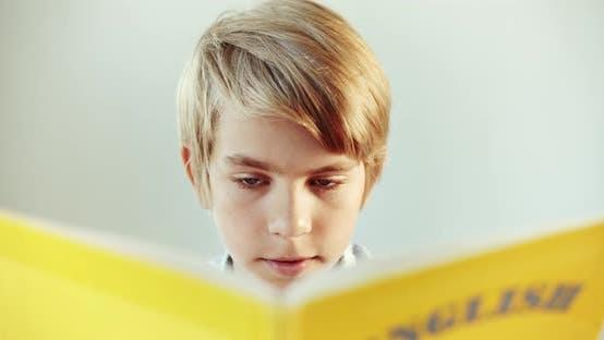 Thumbnail for Boy Reading English Book Closeup