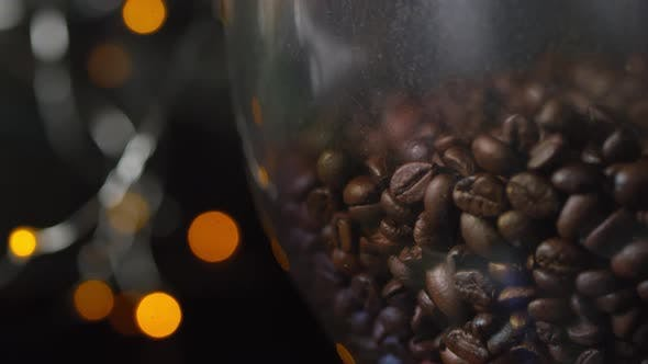 Thumbnail for Freshly Roasted Coffee Beans Poured into Bean Hopper