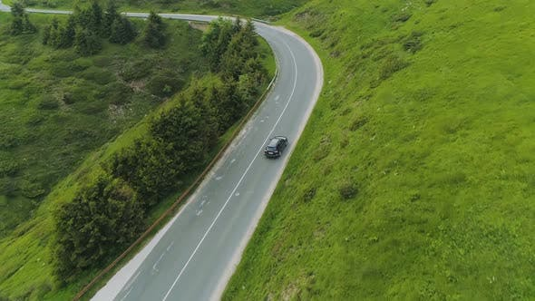 Thumbnail for Drone Follows Car Driving Along Mountain Road