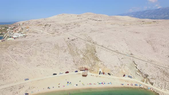 Thumbnail for Flying above tourists on isolated beach of Pag island, Croatia