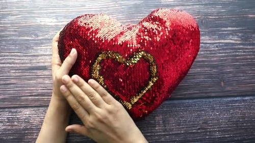 Women Holding Red Heart in Hands