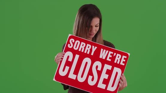 Thumbnail for Millennial woman holding sign reading Sorry We're Closed on greenscreen