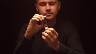 Man Checks Diamond