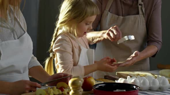 Thumbnail for Little Girl Preparing Cookies with Mother and Grandmother