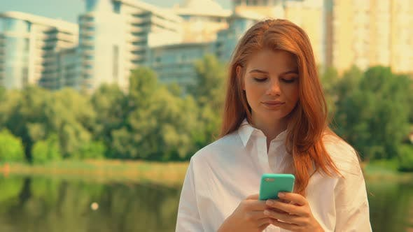 Thumbnail for Portrait Redhead Girl Holding Smartphone