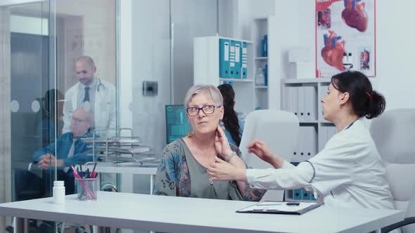 Examining a Patient Throat