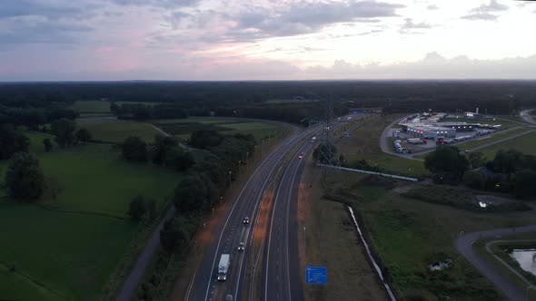 Thumbnail for Aerial Slide Above European Freeway at Sunset with Car Traffic