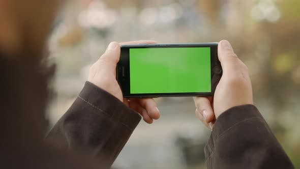 Thumbnail for Man Hands Touching Cellphone with Greenscreen, Unknown Guy Holding Mock Up Phone