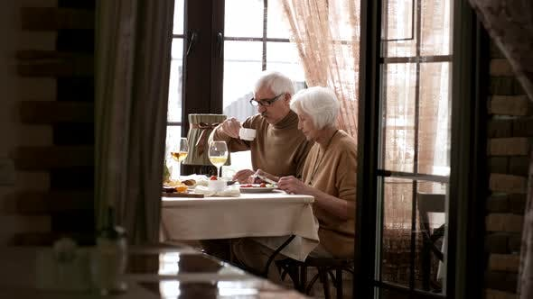 Thumbnail for 60-Something Caucasian Couple Having Emotional Talk at Breakfast