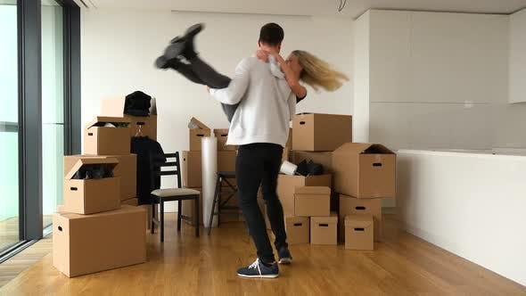 Thumbnail for A Happy Moving Couple Is Excited About Moving Into a New Apartment - Piles of Cardboard Boxes