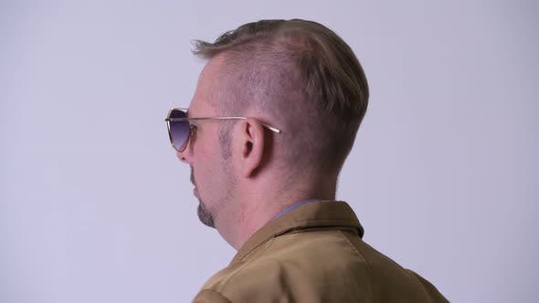 Thumbnail for Rear View of Blonde Casual Businessman Looking Back and Removing Sunglasses
