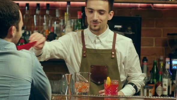 Thumbnail for Barman Preparing Cocktail for a Client and Waiting for His Reaction