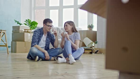 Thumbnail for Couple Drinking Coffee in New House