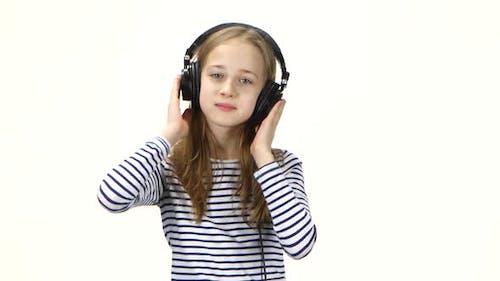 Teenager Girl Listens Music on Headphones, Shakes Head To Beat