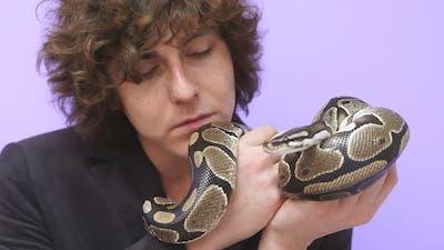 A Snake on a Man's Hand