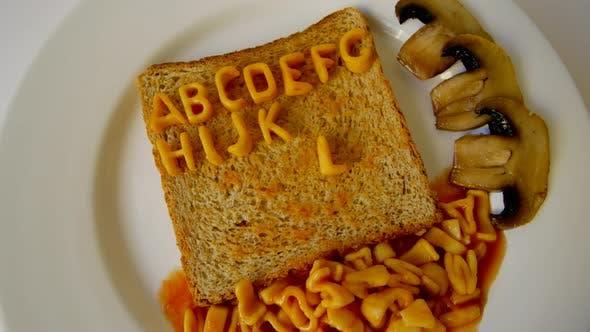 Thumbnail for Alphabet Animation mit Spaghettibuchstaben auf Toast