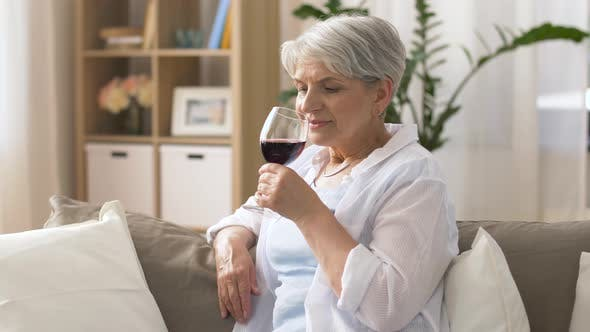 Thumbnail for Senior Woman Drinking Red Wine From Glass at Home 21