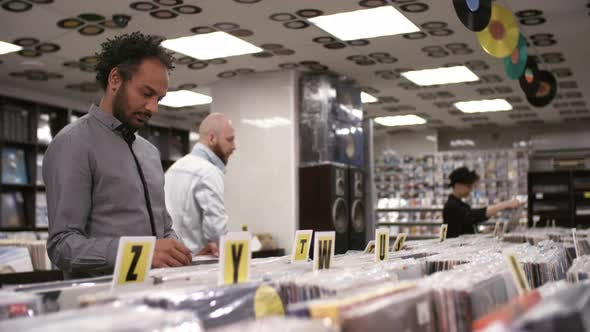 Thumbnail for Multicultural Customers Browsing in Record Store