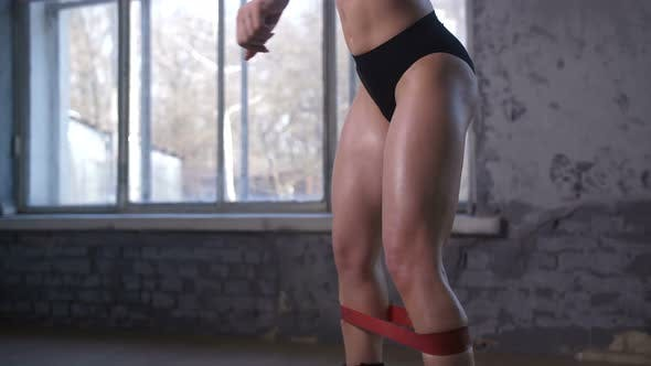Cover Image for Athletic Woman Doing Elastic Band Exersices in Gym