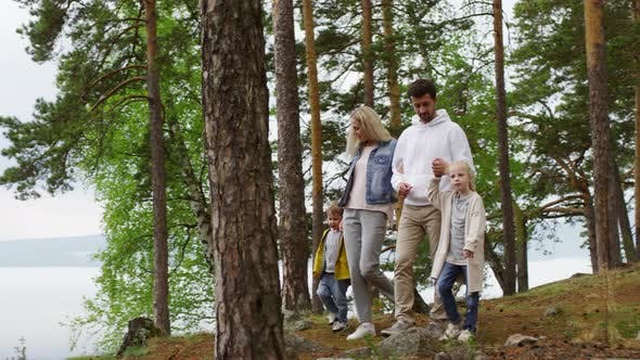 Thumbnail for Family of Four Walking in Scenic Location