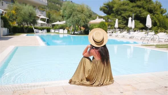 Thumbnail for Woman Relaxing By the Pool in a Luxury Hotel Resort Enjoying Perfect Beach Holiday Vacation