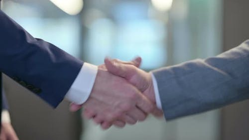 Hand Shake By Two Businessmen at Work