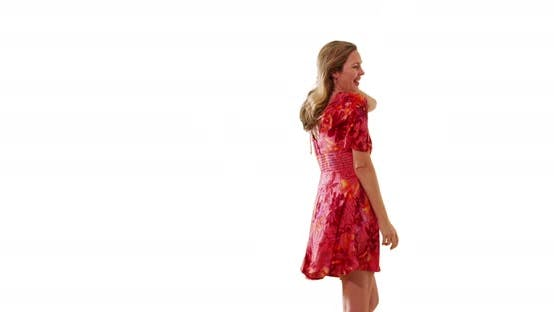 Thumbnail for Woman in sundress dancing, enjoying holiday or vacation in studio with copyspace