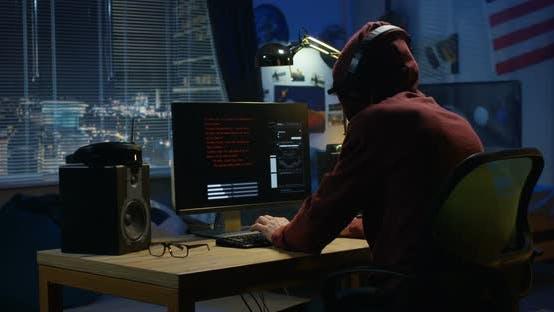 Thumbnail for Programmer Coding at Night