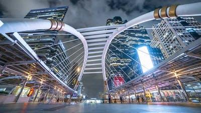Chong Nonsi Bangkok Sky Train Station Public Skywalk Bridge with the Modern Buildings on Background