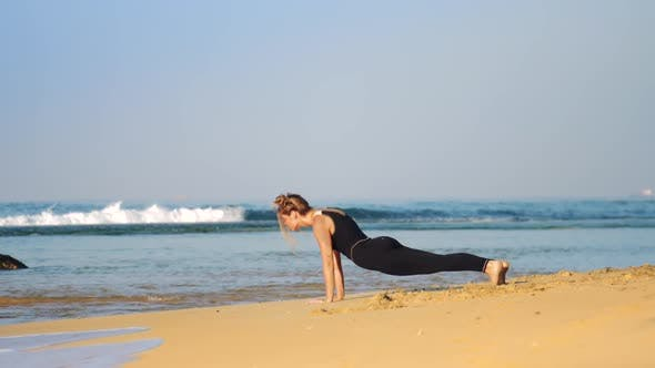 Thumbnail for Girl Changes Yoga Pose Cobra To Downward-facing Dog Pose