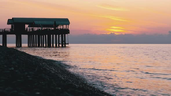 Thumbnail for Panorama of the Sunset Over the Sea Next To the Silhouette of the Pier