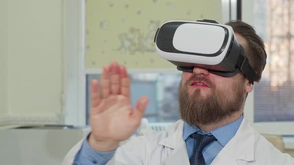 Thumbnail for Male Doctor Using 3d Virtual Reality Glasses at the Hospital