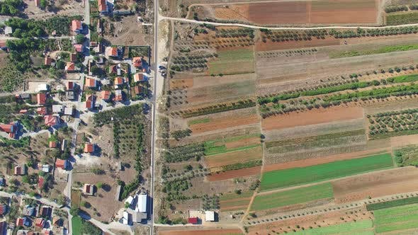 Thumbnail for Aerial view of paved road separating fields from houses, Dalmatia, Croatia