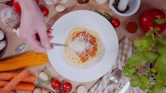 Thumbnail for Person Garnishing Spaghetti With Cheese