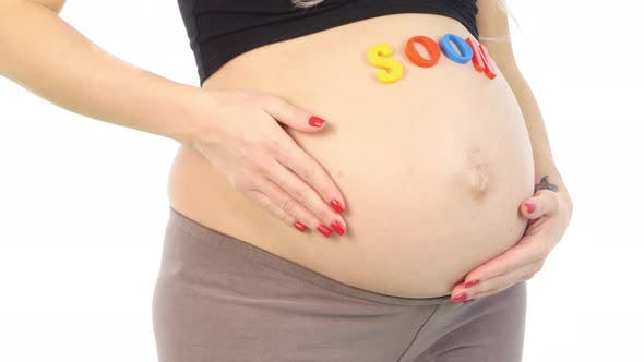 Thumbnail for Cropped Image of Pregnant Woman with Coming Soon Sign on Her Belly Standing, White, Closeup