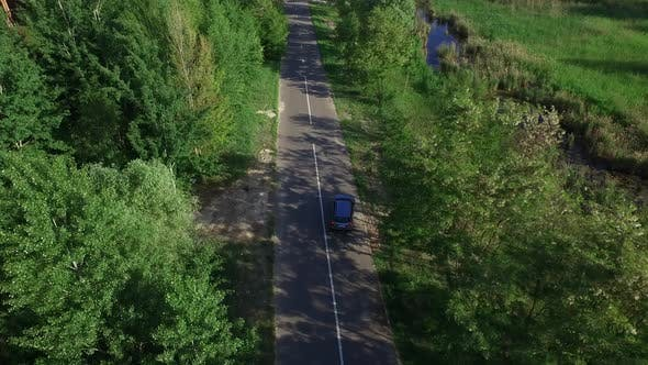 Thumbnail for Car Moving on Countryside Highway. Aerial View Car Turning on Suburban Road