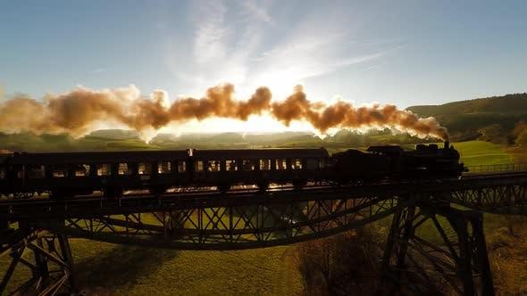Cover Image for Old Retro Vintage Locomotive Train Crossing Railroad Bridge