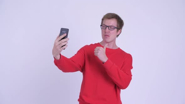 Thumbnail for Happy Young Handsome Man Taking Selfie