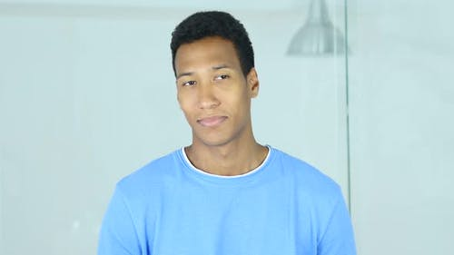 Positive Afro-American Man Looking in Camera