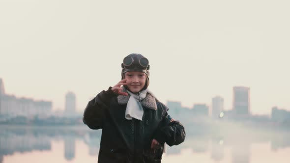 Thumbnail for Beautiful Portrait of Little Girl in Old Pilot Costume on Sunset Near Amazing City Lake