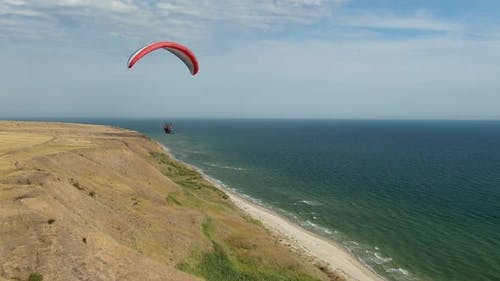 Person Is Paragliding Near the Sea, Landscape View, Extreme Sports