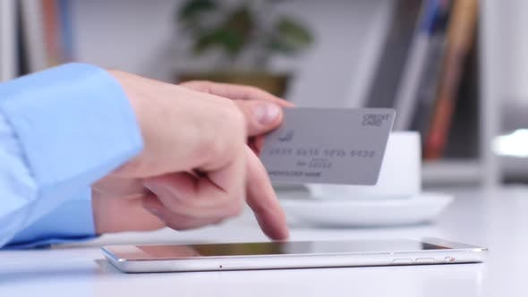 Thumbnail for Man Shopping Online Using Digital Tablet and Credit Card. Close Up
