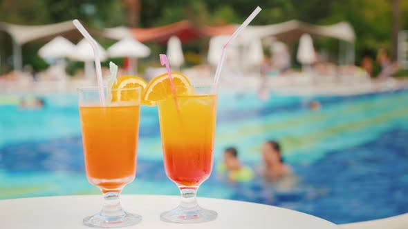 Thumbnail for Two Exotic Cocktails on the Background of the Pool at the Tourist Resort