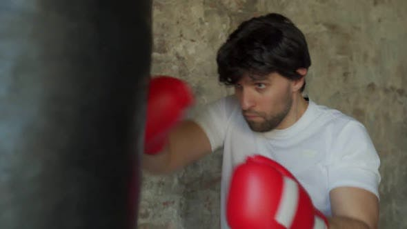 Male Boxer Boxing in Punching Bag Slow Motion